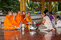 Cambodia, Siem Reap.  Worshipers Seeking Blessing from Buddhist Monks, Preah Ang Chek and Preak Ang Chorm Temple.