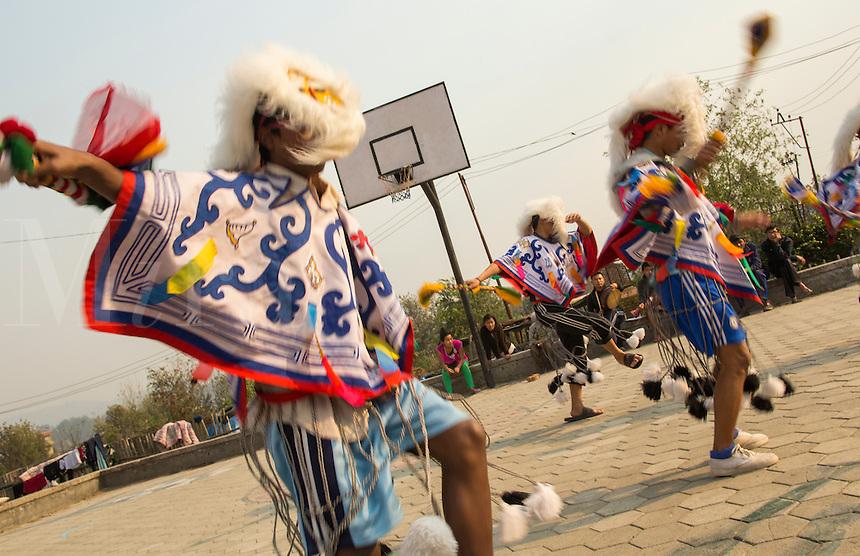 Kathmandu Nepal Nepali boys dance in traditional Tibetan ceremonial costumes and masks in Nayapti, Eastern Kathmandu 1