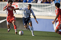 USA's Charlie Davies dribbles ahead of China's Wang Dong (28). The USA defeated China, 4-1, in an international friendly at Spartan Stadium, San Jose, CA on June 2, 2007.