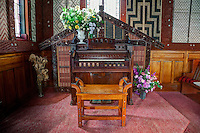 Cultural Syncretism.  Church organ framed in woodwork similar to a wharenui (Maori meeting house), St. Mary's Anglican Church, Tikitiki, north island, New Zealand, built 1924-26 as a memorial to Maori soldiers who fought and died in World War I.   A member of the New Zealand Historic Places Trust.  Highway 35, Gisborne Region.