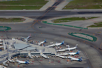 aerial photograph of six Alaska Airlines aircraft at gates at the San Francisco International airport (SFO), San Francisco, California
