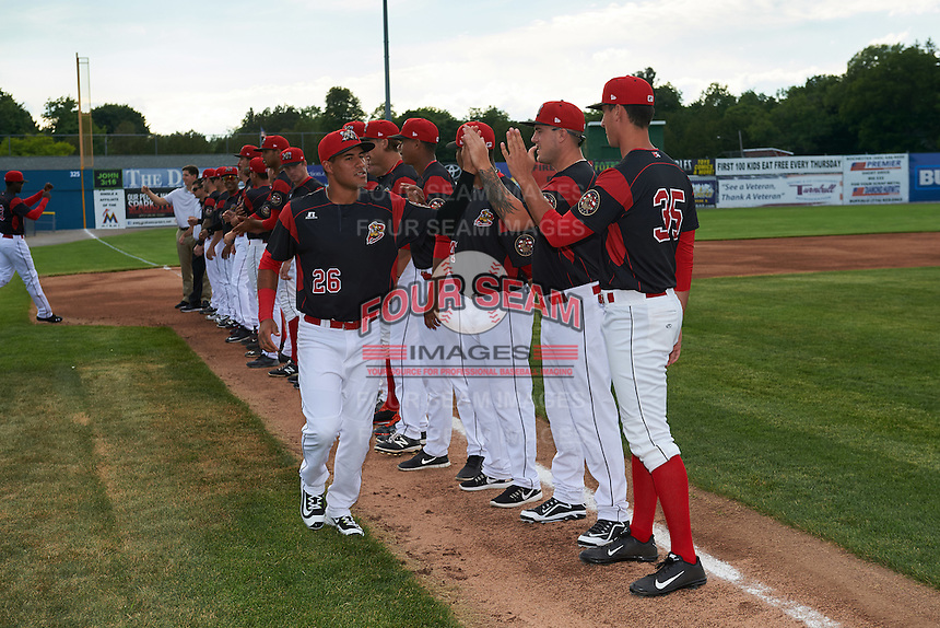 Batavia Muckdogs second baseman Rony Cabrera (26) high fives teammates including Marcus Crescentini (44) and Connor Bach (35) during introductions before a game against the State College Spikes on June 22, 2016 at Dwyer Stadium in Batavia, New York.  State College defeated Batavia 11-1.  (Mike Janes/Four Seam Images)