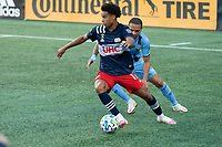 FOXBOROUGH, MA - SEPTEMBER 19: Tajon Buchanan #17 of New England Revolution and Alexander Callens #6 of New York City FC compete for the ball near the New York City goal during a game between New York City FC and New England Revolution at Gillette on September 19, 2020 in Foxborough, Massachusetts.