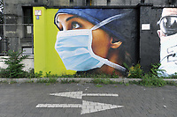- Milano, nel quartiere periferico nord di Quarto Oggiaro, omaggio dell'artista Cosimo Caiffa (Cheone) agli operatori sanitari dell'ospedale Sacco, in prima linea durante l'epidemia di Coronavirus<br />