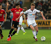 Sam Clucas of Swansea City (R) pushes away Jesse Lingard of Manchester United during the Carabao Cup Fourth Round match between Swansea City and Manchester United at The Liberty Stadium, Swansea, Wales, UK. Tuesday 24 October 2017