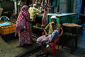 A butchers waits for customers at a stall in the New Market area of Kolkata, West Bengal, India,