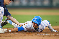 UCLA catcher Shane Zeile (14) dives back to first base during Game 12 of the 2013 Men's College World Series as North Carolina Tar Heels first baseman Cody Stubbs (25) applies a tag on June 21, 2013 at TD Ameritrade Park in Omaha, Nebraska. The Bruins defeated the Tar Heels 4-1, to reach the CWS Final and eliminate North Carolina from the tournament. (Andrew Woolley/Four Seam Images)