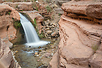 A waterfall on Deer Creek spills over cliffs made of Tapeats sandstone at the head of the Deer Creek Narrows