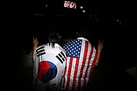 CHINA. Beijing. Fans wearing the flags of South Korea and the USA whilst watching the opening ceremony of the Beijing Summer Olympics. 2008