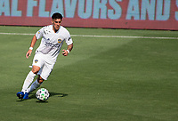 LOS ANGELES, CA - AUGUST 22: Cristian Pavon #10 of the Los Angeles Galaxy moves with the ball during a game between Los Angeles Galaxy and Los Angeles FC at Banc of California Stadium on August 22, 2020 in Los Angeles, California.