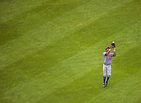 28 July 2013: New York Mets outfielder Eric Young pulls in a fly ball during a game against the Washington Nationals at Nationals Park in Washington, DC. The Nationals defeated the Mets 14-1. Mandatory Credit: Ed Wolfstein Photo *** RAW (NEF) Image File Available ***