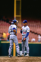 SAN FRANCISCO, CA - Chan Ho Park and Mike Piazza of the Los Angeles Dodgers talk on the mound during a game against the San Francisco Giants at Candlestick Park in San Francisco, California on April 17, 1996. (Photo by Brad Mangin)