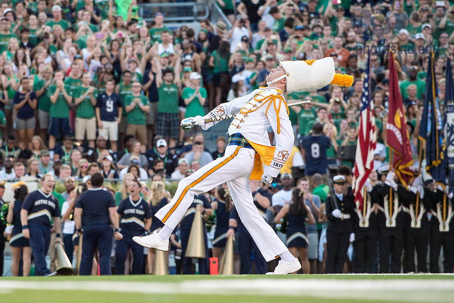 Sept. 5, 2015; Head Drum Major Brandon Angelini leads the band onto the field before the football game against Texas. (Photo by Matt Cashore)