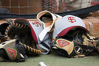 Florida State Seminoles hats and gloves lie on the ground outside the visitors dugout at Gene Hooks Stadium on the campus of Wake Forest University in Winston-Salem, NC, Friday, March 28, 2008.