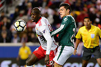 Harrison, NJ - Tuesday April 10, 2018: Bradley Wright-Phillips, Michael Pérez during leg two of a  CONCACAF Champions League semi-final match between the New York Red Bulls and C. D. Guadalajara at Red Bull Arena. C. D. Guadalajara defeated the New York Red Bulls 0-0 (1-0 on aggregate).