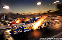 May 29, 2009; Topeka, KS, USA: NHRA funny car driver Ron Capps (near) races Cruz Pedregon during qualifying for the Summer Nationals at Heartland Park Topeka. Mandatory Credit: Mark J. Rebilas-US PRESSWIRE