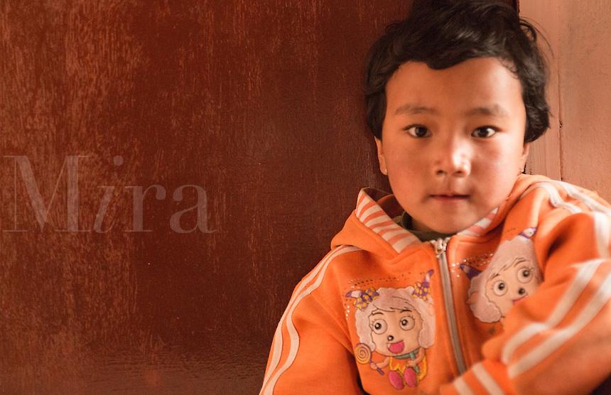 Kathmandu Nepal. Nepali child age 4 plays and poses for camera in Nayapati Eastern Kathmandu.  1