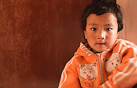 Kathmandu Nepal. Nepali child age 4 plays and poses for camera in Nayapati Eastern Kathmandu.  1
