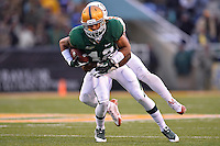 December 07, 2013:<br /> <br /> Baylor Bears inside receiver Levi Norwood #42 is tackled by Texas Longhorns linebacker Peter Jinkens #19 during NCAA football game at Floyd Casey Stadium in Waco, TX. Baylor win BIG 12 championship by defeating Texas 30-10.