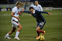 Lorient, France. - Sunday, February 8, 2015: Amel Majri (22) of France holds off Tobin Heath (17) of the USWNT. France defeated the USWNT 2-0 during an international friendly at the Stade du Moustoir.