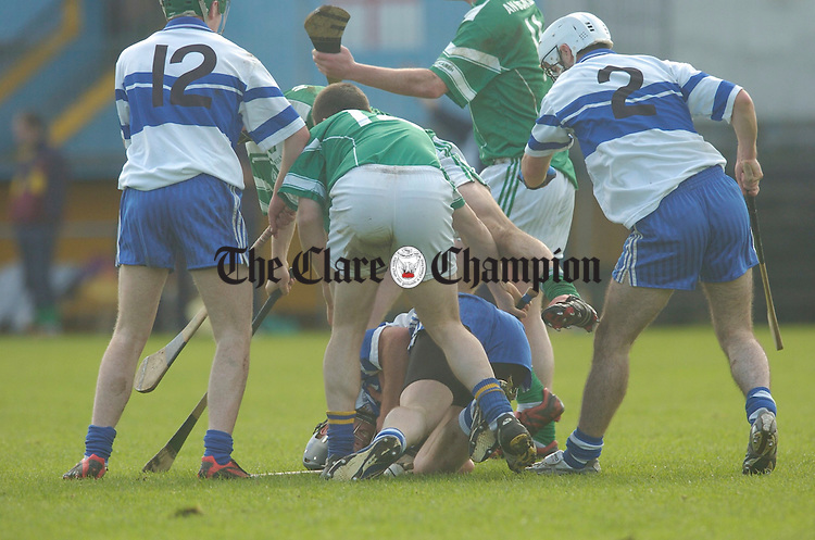 Kilmaley's Anthony Cahill in thi middle of this action during their game against Scariff in Cusack park. Photograph by  John Kelly.