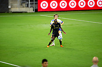 LOS ANGELES, CA - SEPTEMBER 02: Bradley Wright-Phillips #66 of LAFC and Florian Jungwirth #23 of the San Jose Earthquakes battle for a ball during a game between San Jose Earthquakes and Los Angeles FC at Banc of California stadium on September 02, 2020 in Los Angeles, California.