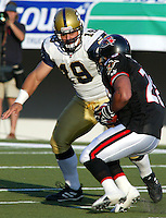 Inoke Brecterfield Winnipeg Blue Bombers 2003. Photo F. Scott Grant