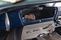 BNPS.co.uk (01202 558833)<br /> Pic: SilverstoneAuctions/BNPS<br /> <br /> Pictured: The glove compartment.<br /> <br /> A classic Porsche has emerged for sale after it was discovered in storage exactly as it was left over four decades ago.<br /> <br /> The 1964 3560C coup with its original blue paintwork is remarkably rare as most of its kind were scrapped after they were superseded by the more popular 911 model.<br /> <br /> Found by the seller in a barn where it languished since it was last driven in 1977, the car is a time capsule full of historic items left untouched for decades.