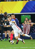 ARLINGTON, TEXAS - Saturday July 22, 2017: Paul Arriola #20 of USMNT moves the ball down field against the Costa Rica National Team in the second half of the match at AT&T Stadium.