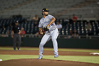 Salt River Rafters relief pitcher Jesus Tinoco (74), of the Colorado Rockies organization, delivers a pitch during an Arizona Fall League game against the Scottsdale Scorpions at Scottsdale Stadium on October 12, 2018 in Scottsdale, Arizona. Scottsdale defeated Salt River 6-2. (Zachary Lucy/Four Seam Images)