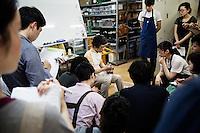 Chiro Yamaguchi is teaching shoe making to students at Sarukawa Footwear College