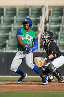 Elier Hernandez (12) of the Lexington Legends follows through on his swing against the Kannapolis Intimidators at CMC-Northeast Stadium on May 25, 2015 in Kannapolis, North Carolina.  The Intimidators defeated the Legends 6-5.  (Brian Westerholt/Four Seam Images)