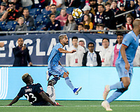 FOXBOROUGH, MA - SEPTEMBER 29: Wilfried Zahibo #23 of New England Revolution trips up Maximiliano Moralez #10 of New York City FC during a game between New York City FC and New England Revolution at Gillette Stadium on September 29, 2019 in Foxborough, Massachusetts.