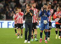 Brentford Manager, Thomas Frank applauds the home fans at the end of the match alongside David Raya during Brentford vs Liverpool, Premier League Football at the Brentford Community Stadium on 25th September 2021