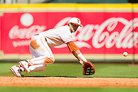 First baseman Kirby Bellow #13 of the Texas Longhorns dives for a ground ball against the Arkansas Razorbacks at Minute Maid Park on March 4, 2012 in Houston, Texas.  The Razorbacks defeated the Longhorns 7-3.  Brian Westerholt / Four Seam Images