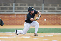 Joey Rodriguez (8) of the Wake Forest Demon Deacons drops down a bunt against the Clemson Tigers at David F. Couch Ballpark on March 12, 2016 in Winston-Salem, North Carolina.  The Tigers defeated the Demon Deacons 6-5.  (Brian Westerholt/Four Seam Images)