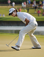 Kelly.Jordan@jacksonville.com--051212--Kevin Na uses body language to guide his putt in the hole on 16 which gave him the tie for the lead at 11 under par during The Players Championship at TPC Sawgrass Saturday May 12, 2012 in Ponte Vedra Beach, Florida.(The Florida Times-Union, Kelly Jordan)
