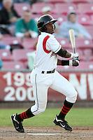 Salem-Keizer outfielder Shawn Payne #5 bats against the Eugene Emeralds at Volcanoes Stadium on August 9, 2011 in Salem-Keizer,Oregon. Eugene defeated Salem-Keizer 13-7.(Larry Goren/Four Seam Images)