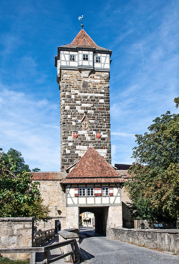 The Rödertor, or Röder Gate, was built in the late 14th century and forms part of Rothenburg's outer fortifications that were constructed after the town expanded beyond the original town walls.