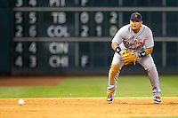 Detroit Tigers third baseman Miguel Cabrera (24) tracks a ground ball during the MLB baseball game against the Houston Astros on May 3, 2013 at Minute Maid Park in Houston, Texas. Detroit defeated Houston 4-3. (Andrew Woolley/Four Seam Images).