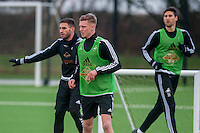 Wednesday  06 January 2016<br /> Pictured L-R: Angel Rangel, Adam King and Federico Fernandez of Swansea in action during training<br /> Re: Swansea City Training session at the Fairwood training ground, Swansea, Wales, UK
