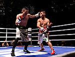 Hin Leong of Macao battles Raymond Poon of Hong Kong during their light flyweight fight, as part of the Clash of Champions on 14 May 2016 in Hong Kong, China. Photo by Victor Fraile / Power Sport Images