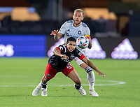 WASHINGTON, DC - MAY 13: Edison Flores #10 of D.C. United is fouled by Francisco Calvo #5 of Chicago Fire FC during a game between Chicago Fire FC and D.C. United at Audi FIeld on May 13, 2021 in Washington, DC.