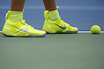 Victoria Azarenka's shoes match the ball perfectly and contrast with the court at the US Open in Flushing, NY on September 3, 2015.