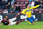 Hearts v St Johnstone...05.02.12.. Scottish Cup 5th Round.Fran Sandaza goes flying after a challenge by Andy Webster.Picture by Graeme Hart..Copyright Perthshire Picture Agency.Tel: 01738 623350  Mobile: 07990 594431