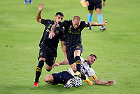 LOS ANGELES, CA - SEPTEMBER 23: Lucas Cavallini #9 of the Vancouver Whitecaps battles with Mohamed El-Munir #13 and Eduard Atuesta #20 of LAFC during a game between Vancouver Whitecaps and Los Angeles FC at Banc of California Stadium on September 23, 2020 in Los Angeles, California.