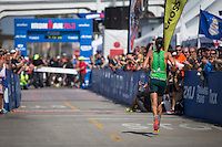 Heather Wurtele runs down the finishing chute as the winner of the Accenture Ironman California 70.3 in Oceanside, CA on March 29, 2014.