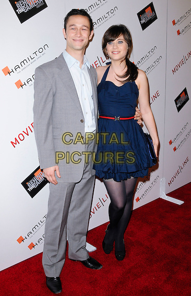 JOSEPH GORDON-LEVITT & ZOOEY DESCHANE.arriving at the 4th Annual Hamilton Behind The Camera Awards at The Highlands in Hollywood, California, USA, November 8th 2009..full length grey gray suit navy blue dress halterneck ruffle red waist belt black shoes bows tights stockings clutch bag.CAP/ROT.©Lee Roth/Capital Pictures
