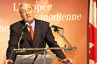 March 27. 2002, Montreal, Quebec, Canada; <br /> <br /> Paul Martin,Canada's Minister of Finance (and possible replacement to Liberal leaderJean Chretien)<br /> unveil The second bank note in the new Canadian<br /> Journeyl, March 27th, 2002  in Montreal, Canada.<br /> <br /> Guests including Jean B»liveau, former NHL hockey player for the Montr»al Canadiens,<br />  Kim St. Pierre, member of the gold-medal-winning<br /> Canadian Olympic women's hockey team in Salt Lake City,<br />  and Myriam B»dard, Olympic gold medallist in the biathlon <br /> where attending the event that took place early this morning at the AMC Pepsi Forum Cinemas (build onside the former Forum hockey rink).<br /> <br /> The new $5 note will be available at financial institutions across Canada at approximately 10:30 a.m., on Wednesday, 27 March 2002