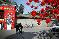 CHINA. Scene during Chinese New Year in Ditan Park in Beijing.  Chinese New Year, or Spring Festival, is the most important festival and holiday in the Chinese calendar In mainland China, many people use this holiday to visit family and friends and also visit local temples to offer prayers to their ancestors. The roots of Chinese New Year lie in combined influences from Buddhism, Taoism, Confucianism, and folk religions.  2008.